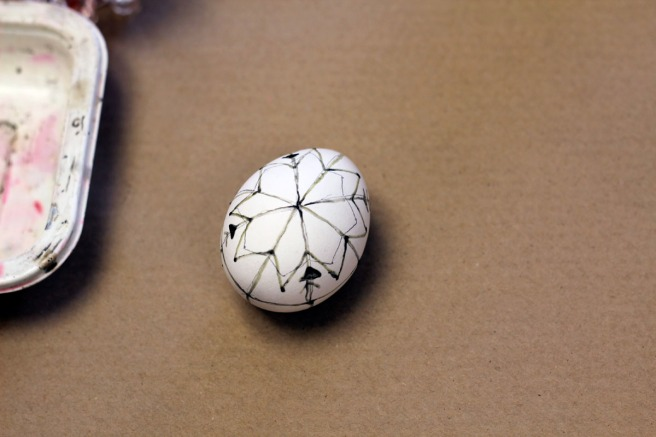 "The basis of the pysanka design, which was first drawn on in pencil. Traditionally the ""arrows"" you see on the lines are supposed to be pussy willows, which replace palms on Palm Sunday"