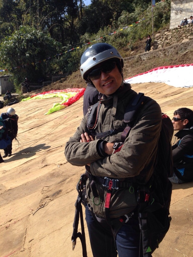 Laxman! He has been paragliding for seven years and goes up with tourists three times a day.