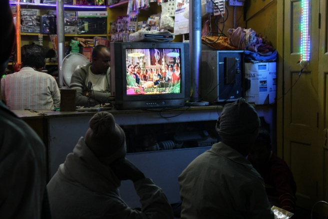 I loved this - informal Bollywood movie-watching sessions in front of local shops.