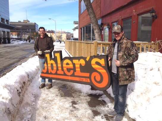 Bye, bye, old sign! Steve and Chris approve of the change.