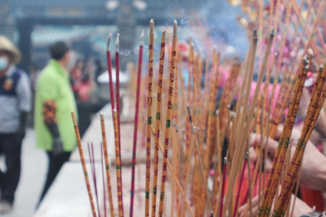 Incense burns at Wong Tai Sin Temple in Hong Kong - Chinese New Year offerings.